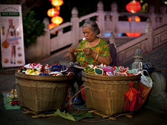 """Shoes... (Michael Steverson) Tags: china street woman night canon asian shoes yangshuo chinese chinadigitaltimes 5d vendor guangxi markii ef50mmf12lusm"