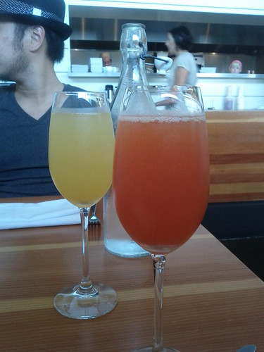 Brunch cocktails. Bellini and blood orange mimosa at Olivia  in Austin, Texas by Melody Gourmet Fury