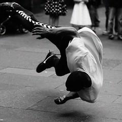 breakdance #1 (backroom.angel) Tags: street square mono scotland blackwhite edinburgh breakdance 500x500 canonef85mm18 magicsquarepoetry asquaresuperstarstemple 500compbw89