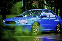 Suburban Jungle (bluejetjane) Tags: auto blue reflection 2004 water car rain nikon automobile subaru waterdrops impreza wrx worldrally worldcars d5100