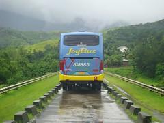 JoyBus passing through Canili-Diayao Dams (Normand Seven) Tags: bus coach dam philippines transport motors aurora daewoo genesis santarosa executive province baler canili joybus 818385 diayao