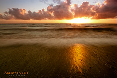 Aberystwyth (Axleuk) Tags: sunset orange seascape beach sand soft waves moody longexosure cluouds canon7dlandscape
