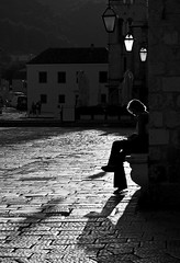 The Journal (Gremxul) Tags: shadow people blackandwhite bw black monochrome silhouette composition contrast canon square shadows highcontrast croatia powershot negativespace piazza hvar townsquare g12 blackwhitephotos gremxul canong12 canonpowershotg12