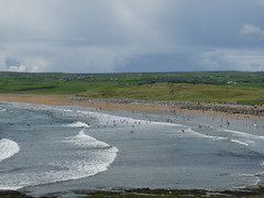Lahinch Beach (Alan Travers) Tags: camping ireland sea beach silhouette reflections cow surf clare waves cliffs surfers hoof hurling snout lahinch hurl lehinch