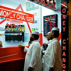 Show me the money (allthatbass) Tags: street red white money colors singapore moneychanger kufi thawb thobe