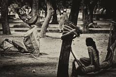 Streets of Dhaka : High Spirits (Shutterfreak ☮) Tags: poverty life street girl monochrome vintage fun garbage nikon mood happiness rope lakeside hanging dhaka pavementdweller inkiad