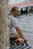 giochi di bimbi (gufino (out for awhile)) Tags: como lago italia uomo lombardia panchina bambolotto isolacomacina