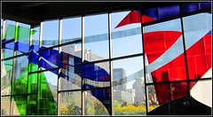 View Of Buildings Through Colours (cleofysh) Tags: city flowers windows art buildings downtown designs colourful stm champsdemars mtrodemontral metrostation vieuxmontral stainedglasswindows sunllight oldmontral montralqubeccanada colorbluegreenredpurple