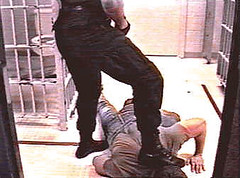 Cop Domination 7 (TBTAOTW2011) Tags: cop police uniform leather black boots bootlick boot worship lick prisoner abuse domination humiliation academy men dominant shine polish