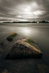 The Coming Storm (philessing) Tags: longexposure bw canada water clouds landscape blackwhite rocks quebec montreal dramatic overcast 5d lasalle canonef1740mmf4lusm lightroom saintlawrenceriver canoneos5d nd110