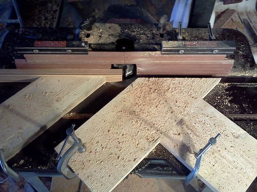 Milling the muntin stock, fed from the left, and making good use of featherboards.