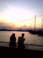 TALKING TO  the SUNset (dimitra_milaiou) Tags: life city friends sunset sea 2 summer two sky people orange woman sun man water coffee silhouette port boats greek lights town nokia marine couple europe sailing ship shadows yacht hellas athens greece imagination athena ports athina flisvos dimitra hellenic x6 floisvos φιλοι αθηνα ελλαδα δυο νερο μαρινα δημητρα milaiou δημητραμηλαιου μηλαιου