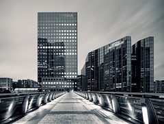 Prisma (Philipp Klinger Photography) Tags: street longexposure bridge windows light bw white black paris france reflection building window architecture modern night facade reflections lights blackwhite frankreich long exposure ledefrance slow nocturnal angle geometry walk wide shapes pri