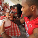 Wide receiver Jay Smith signs a helmet for an adoring fan.