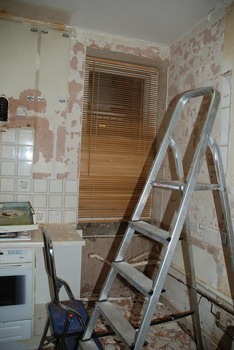 walls de-cabinetted and de-tiled