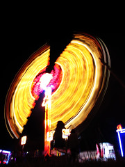 Spinning Fairground Ride 3 (preynolds) Tags: from motion blur festival lights big movement view photos nighttime spinning chill yellowlights fairgroundride 2011x