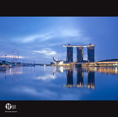Uniquely 46 : City of Lion (Tomatoskin) Tags: sea moon reflection sunrise pov resort bluehour kam casinos stb structure floating helixbridge esplanadedrive sigma10mm20mm singaporeflyer marinabaysands singaporetourismboard canoneos40d tomatoskin locationsingapore integratedresortir singaporeaneuphemism uniquelysingapore2010 bluehoursingapore gettyimagessingaporeq1 gettyimagessingaporeq2 uniquely46cityoflion