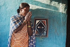 Paroja woman, Orissa, India (ingetje tadros) Tags: travel family light portrait people woman india house color smile architecture canon hands community worship respect religion praying culture marriage shy tribal tribes tradition orissa humble indigenous gond animalhusbandry 5126 tribalwoman indianstreetphotography tribalhouse tribaljewelry internationalgeographic stunningphotos parojatribe gadabatribe stunningphotogpin best4gpin wetcultivation khondttribe