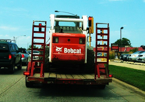 Bobcat tractor in transit.  Niles Illinois USA.  August 2011. by Eddie from Chicago