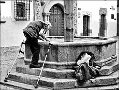 Washing (MarjanTenk) Tags: street blackandwhite homeless washing laspalmas