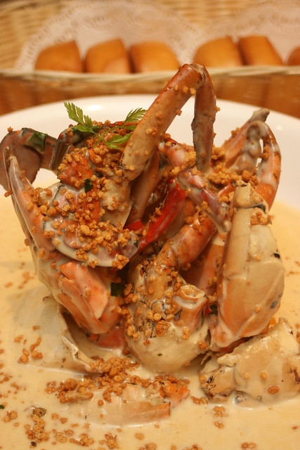 Signature Creamy Butter Crab Topped with Coconut Crumbs, served with buns