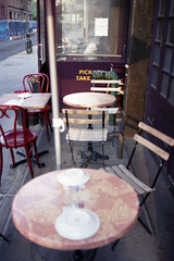 take your pick (dalioPhoto) Tags: nyc newyork film vertical cafe nikon fuji manhattan text sidewalk tables f4s pro160s autaut daliophoto marcdalioall