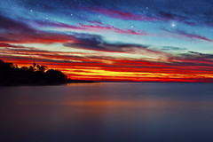 Beautiful night in Darwin [Explored] (Jesper Blow) Tags: blue sunset red sky cloud moon color water yellow night clouds canon stars colours oz nt australia darwin aussie northernterritory 24105mm 50d