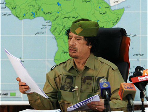 Libyan leader Muammar Gaddafi, the founder of the Al-Fateh Revolution of September 1, 1969. Gaddafi is mounting resistance to the imperialist invasion of his oil-rich North African state. by Pan-African News Wire File Photos