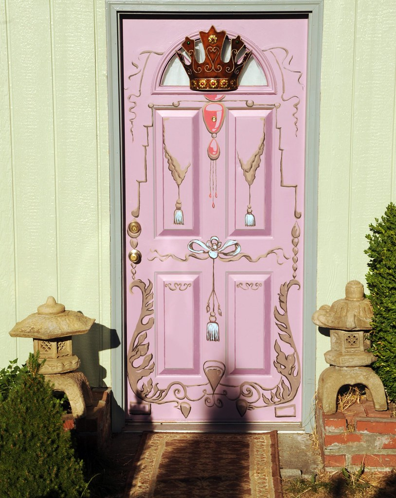 Lilac front door, decorative, French style, crown, ribbons, jewels, leaves, tassels, golden fleece, Japanese stone lanterns, brick, bushes, Broadview, Seattle, Washington, USA