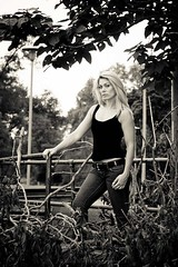 Vanessa, black top, #4 (Mike Wood Photography) Tags: wood trees vanessa portrait woman mike beautiful hair outdoors framed branches longhair jeans rights blonde tanktop railing curve breeze reserved photographymike woodarrall blackandwhitebuildingbweos450d