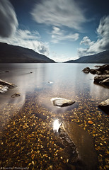 Loch Lomond Light (.Brian Kerr Photography.) Tags: light mountains canon reflections landscape scotland rocks clarity scottish pebbles clear lochlomond eos5dmkii briankerrphotography