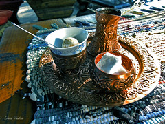 turkish coffee served in bosnia (dario vukovic) Tags: turkish coffee served bosnia banjaluka turska kafa dezva bosanska kahva qahwah  originally travelphotography ngc shoot details digital light hdr sony dschx5v pic photos caf copper cu sugar cubes sugarcubes biscuit kahve    kava   fincan fildan filxhan  cup foam hot drink roasted preparation traditional cooked burnt taste spoon kpk  bitter flavour aroma fragrance bouquet smell fragrancy arabika arabica kafana slap bl wooden table ponjava cloth oriental ottoman bih sunshine