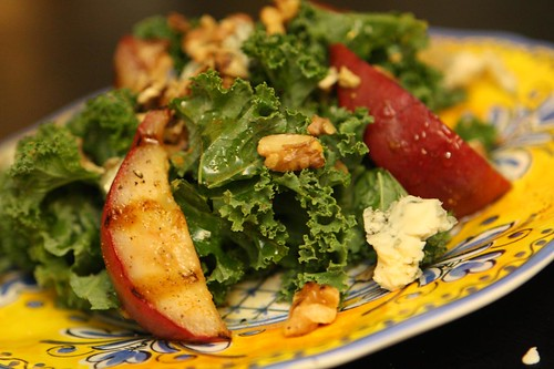 Grilled Red Clapp Pears with Kale, Toasted Walnuts, Sambar Powder, and Fourme d'Ambert