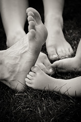 A long way to go, together (Alexandre Moreau | Photography) Tags: blackandwhite woman baby 3 male feet up grass relax foot 50mm three kid toes dad child mum together barefoot familly differentsize