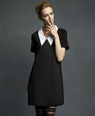 Model wearing Wednesday Addams-style, Lagerfeld dress.