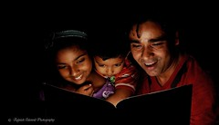 Story Time With Daddy (rajnishjaiswal) Tags: laughing 50mm reading nikon gimp story rashi fatherandchild dadandkids offcameraflash rajnish readingstories sb700 vrisan daddyreadingstoriytokids