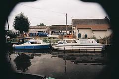 River Cruisers (Sam Tait) Tags: camera england film 35mm river asda photography boat canal nikon fuji leicestershire machine sigma tudor processing mm expired 35 cruiser grp 18200mm f55