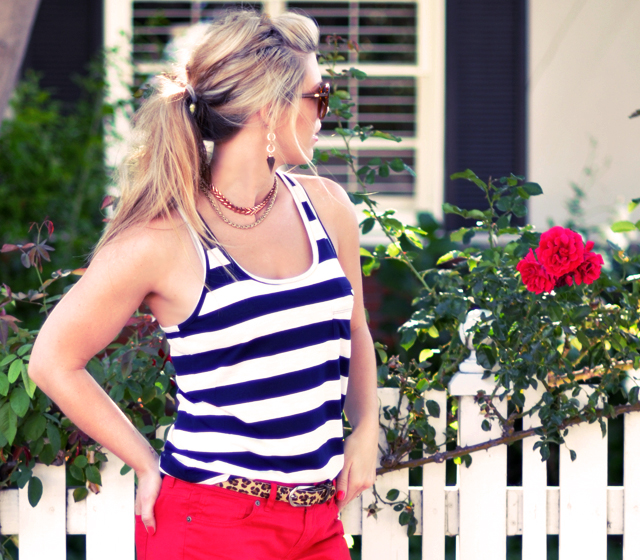 thick  stripes and  red pants  with leopard belt and messy pony tail
