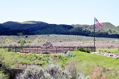 Mountain Meadows - 1999 Monument from parking lot (brondabailey) Tags: monument massacre flag mountainmeadows