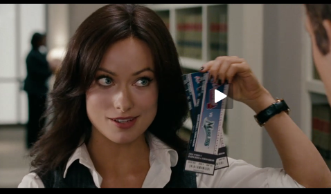 screen shot of Olivia Wilde holding up a pair of baseball tickets