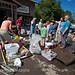 David McDonough (turquoise shirt) owner of Keene Vally Hardware, looks at damaged goods from his store as friends and neighbors help with the clean-up. photo by Nancie Battaglia