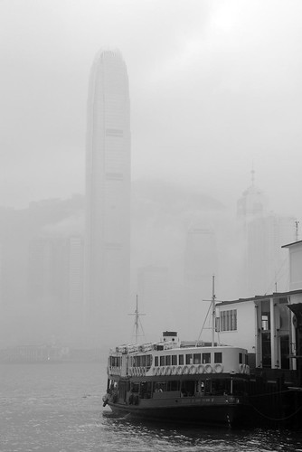 Victoria harbour is hidden in the mist