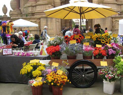 the flower cart and puppet vendors