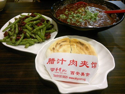 Clockwise from bottom: La Zhi Roujiamou, Hot and Sour Noodles, and String Beans