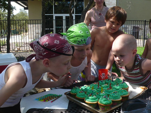 Max and Billy helping Sparky blow out his candles