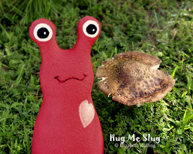 Tomato red fleece Hug Me Slug original art toy by Elizabeth Ruffing