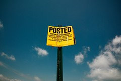 Posted! (MilkaWay) Tags: summer sign yellow clouds warning perspective bluesky posted etc notrespassing privateproperty oconeecounty nohunting nofishing yellowsign ruralgeorgia