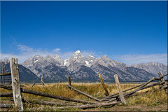 Fenced In Tetons (Jill Clardy) Tags: park wood blue sky fence wooden day decay barns grand clear national valley fallen 100views antelope wyoming tetons wy moulton hff 4603 2011jillclardy