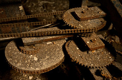 exercise bike gears (Jonathon Much) Tags: city windows shadow brown chicago macro texture abandoned geometric broken bike bicycle metal closeup america buildings illinois rust shadows dof exercise mechanical bokeh geometry antique decay metallic urbandecay details debris rusty gear dirty depthoffield chain textures urbanexploration rusted rusting aged discarded decomposition exploration gears distressed crusty cracked decayed decaying components spiked crumbling lawndale crumbled urbex deteriorating crusted decomposing 2011 stjohnofgod detroyed canon7d stjohnofgodchurch jonathonmuch