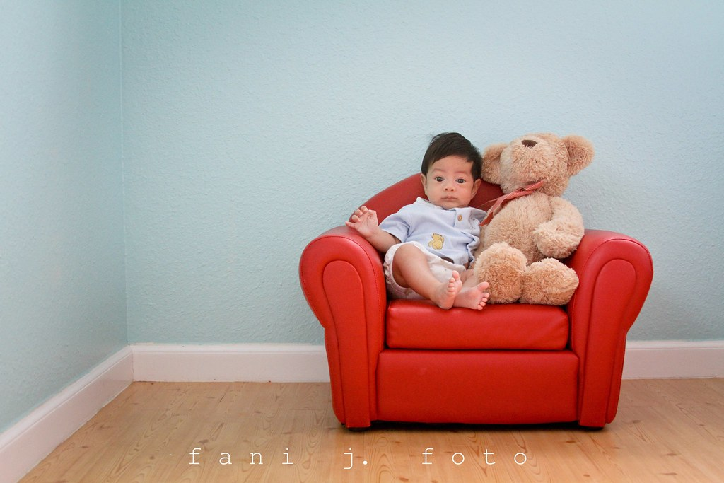 a chair and a bear